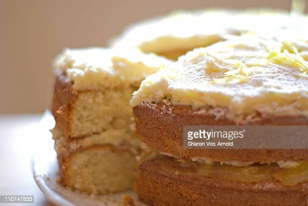 Lemon cake, with the first slice cut