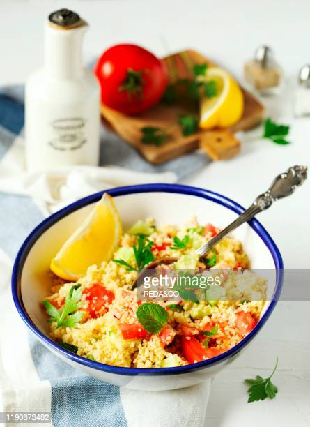 Lemon couscous Couscous with tomato cucamber lemon and herbs Traditional Arabic Salad Tabbouleh