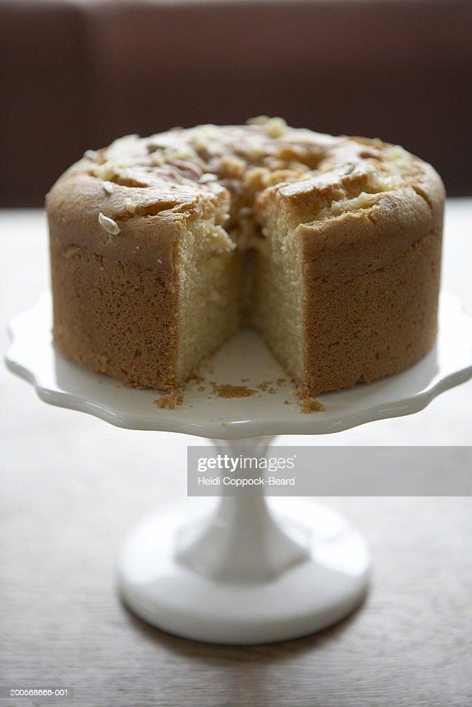 Lemon drizzle cake on cake stand : Stock Photo