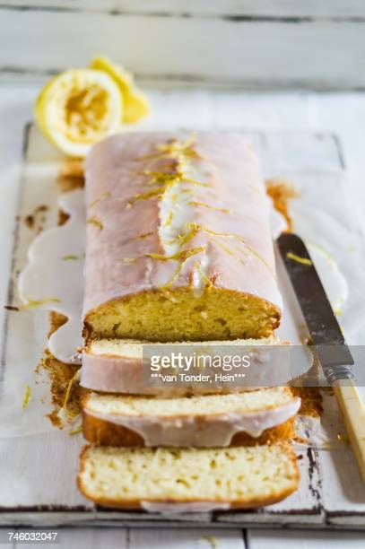 lemon drizzle cake, sliced - fruit cake stock pictures, royalty-free photos & images
