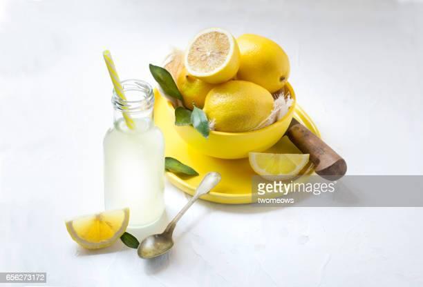 Lemon fruit pile on white background.