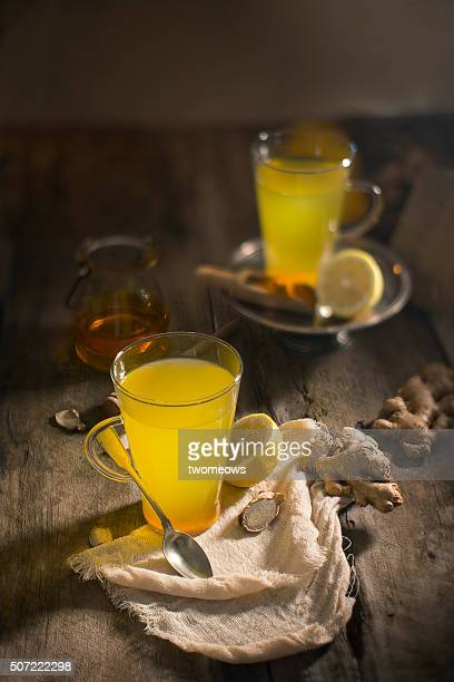 Lemon, ginger root and turmeric powder detox liver fat burnner healthy drinks.
