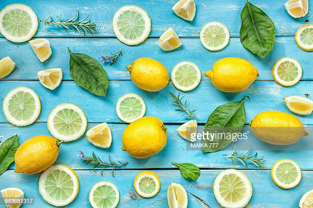 Lemon, leafs & slices of lemon on blue wood table