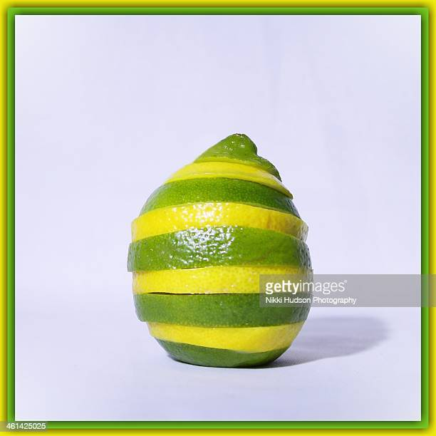 Lemon lime fruit with green yellow stripe slices