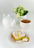 http://www.istockphoto.com/photo/lemon-meringue-pie-cup-of-tea-white-roses-and-teapot-on-table-or-background-vertical-gm890982666-246792140