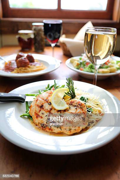 Lemon Rosemary Chicken Plate Accompanied By A Goblet Of Wine