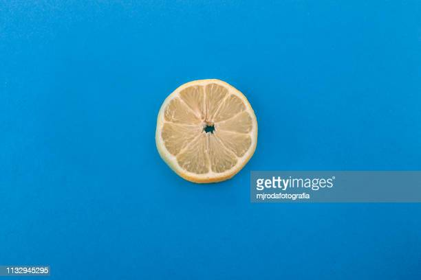 lemon slice. - fruta stock photos and pictures