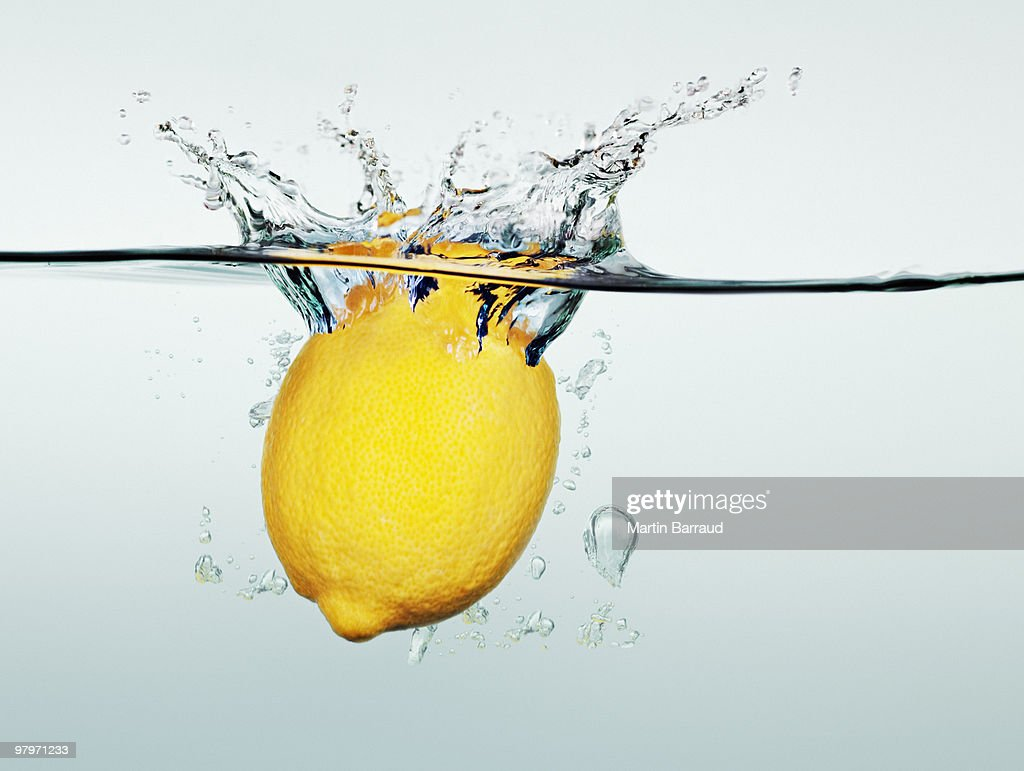 Lemon splashing in water : Stock Photo