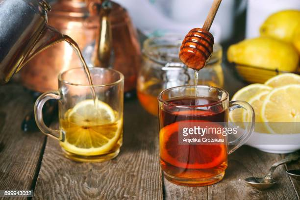 lemon tea with honey. - tea leaves stock photos and pictures