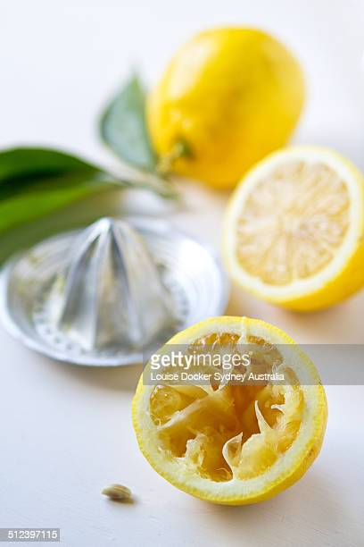 lemon that has been hand juiced - crushed leaves stock pictures, royalty-free photos & images