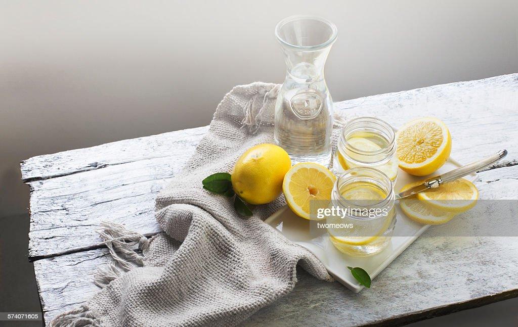 Lemon water on white wooden table. Still life. : Stock Photo