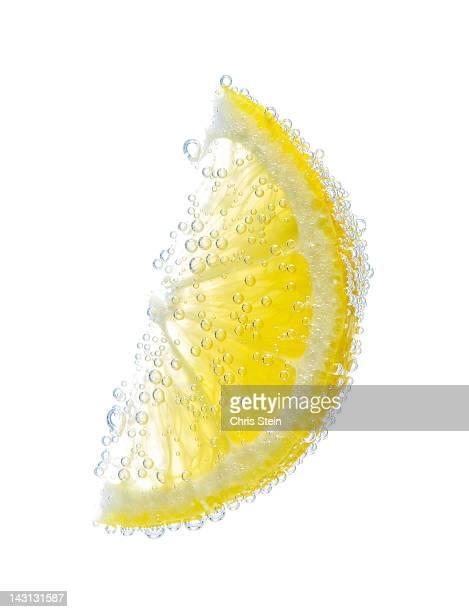 Lemon wedge with bubbles