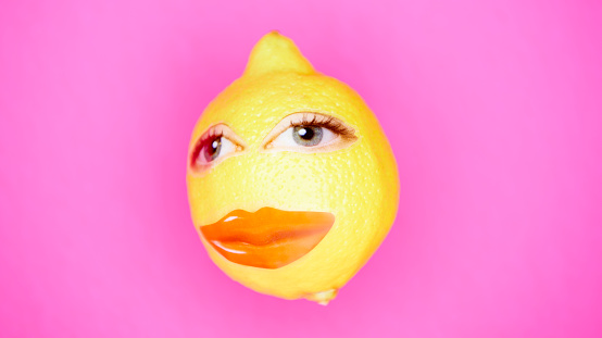 lemon with face on pink background - gettyimageskorea