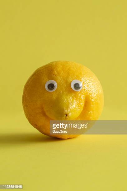 lemon with googly eyes - googly eyes stock pictures, royalty-free photos & images