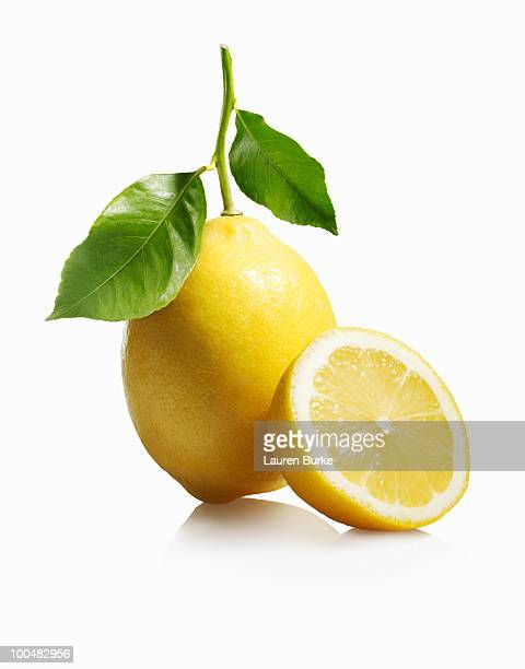 lemon with leaves on white background - zitrone stock-fotos und bilder