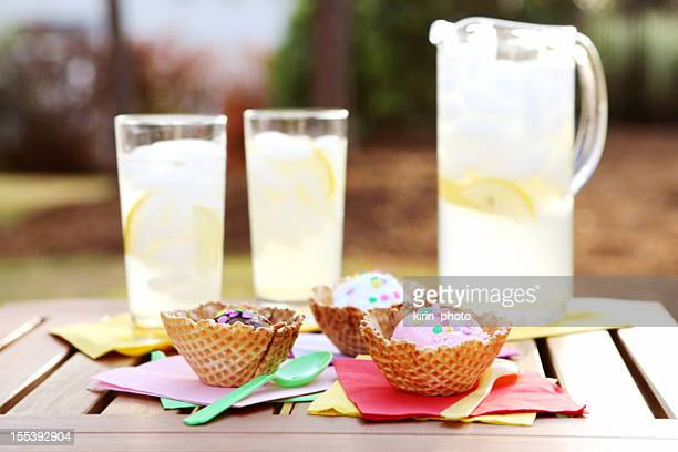 lemonade and ice cream in waffle bowls outside on the patio - lemon soda stock pictures, royalty-free photos & images