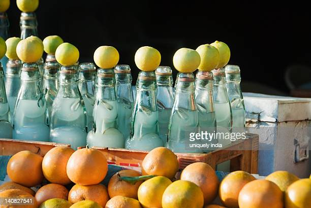 Lemonade bottles and kinnows at a food stall, Vaishno Devi, Katra, Jammu And Kashmir, India