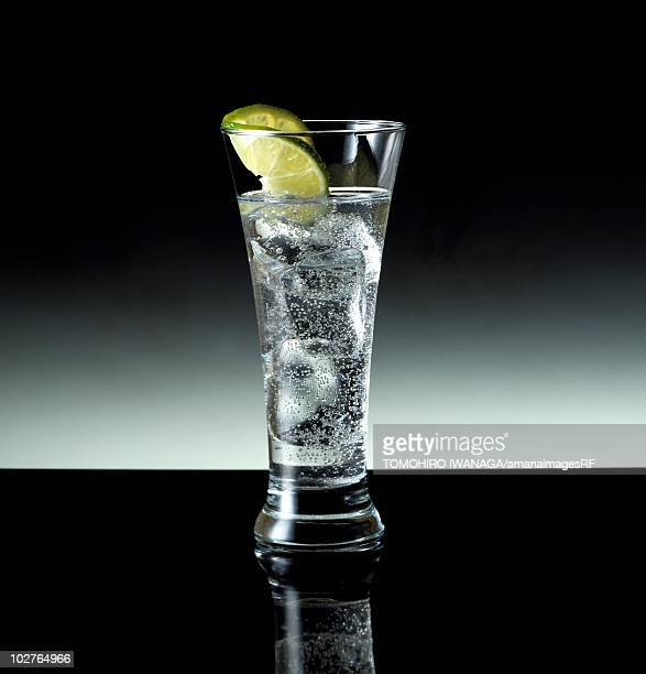 Lemonade in a highball glass with lime garnish