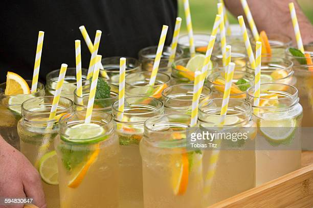 Lemonade in mason jars with drinking straws