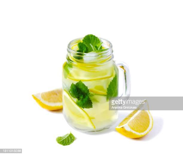 lemonade. mason jar glasses of lemonade with mint - freshness stock pictures, royalty-free photos & images