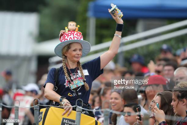 Lemonade vendor Jeannine Conway of Weymouth Mass sells lemonade wearing birthday apparel for New England Patriots Tom Brady during training camp at...