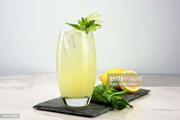 lemonade with mint - cold drink stock pictures, royalty-free photos & images
