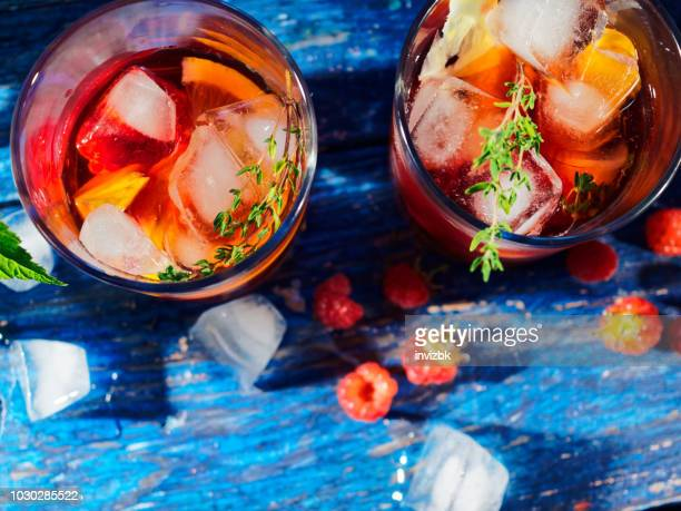 lemonade with raspberry, peach and thyme - sangria stock pictures, royalty-free photos & images