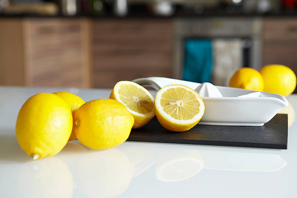 Lemons And Juicer On Kitchen Counter Wall Art