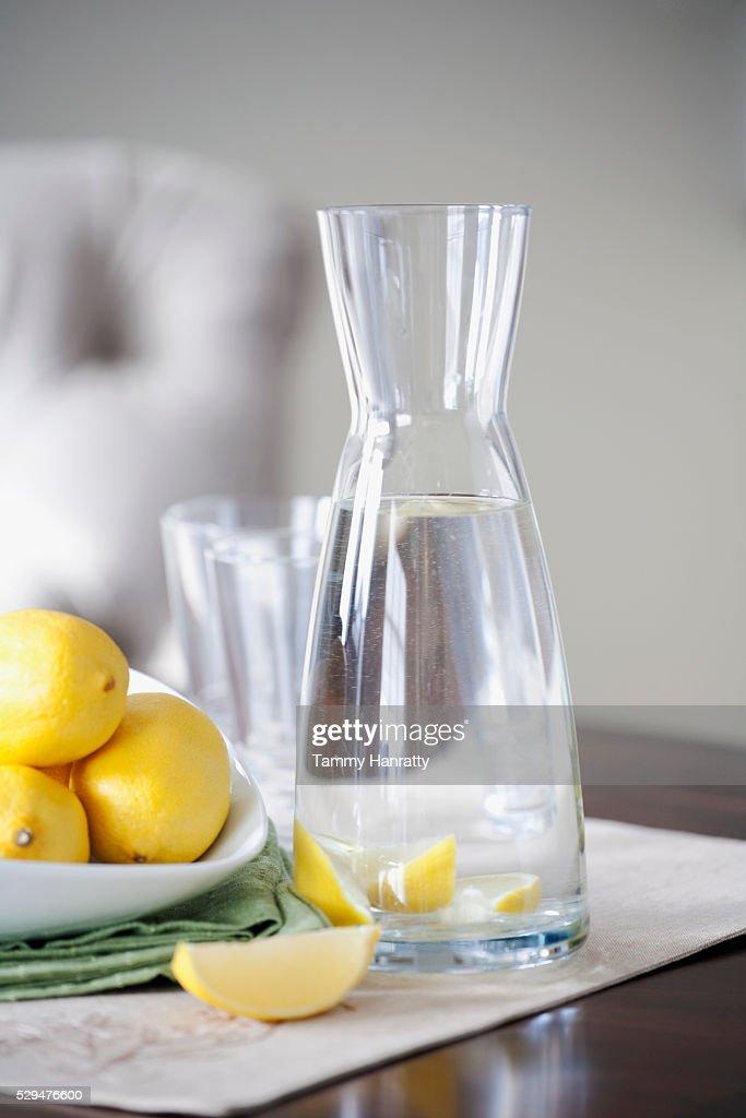 Lemons and water : Stock Photo