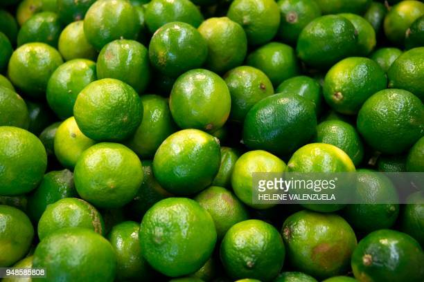Lemons are pictured at the fruit and vegetable department of an 'O Marche' supermarket in SaintFrancois on the French overseas territory of...