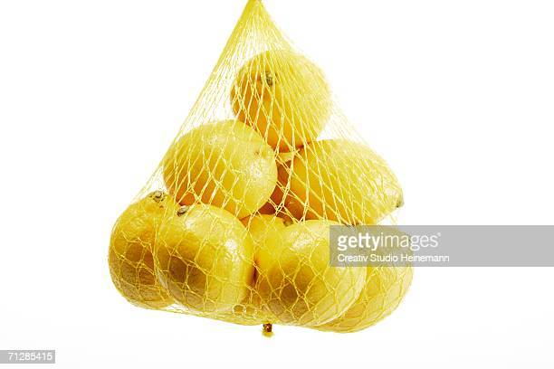 lemons in a net close-up - 網状 ストックフォトと画像