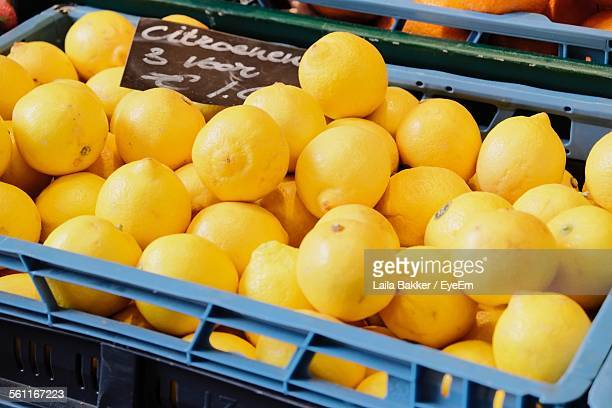Lemons In Crate Displayed For Sale At Market