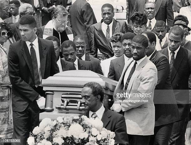 Len Bias' casket leaves the University of Maryland. Brother Jay Bias, weeping, is at top center. His father James Bias and mother Lonise Bias are...
