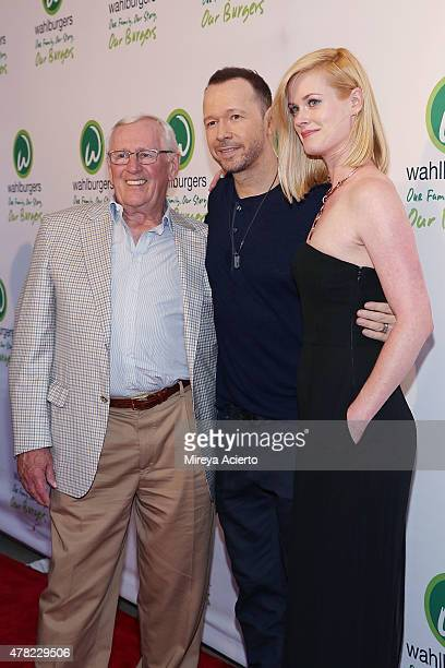 Len Cariou Donnie Wahlberg and Abigail Hawk attend the Wahlburgers Coney Island VIP Preview Party at Wahlburgers Coney Island on June 23 2015 in New...