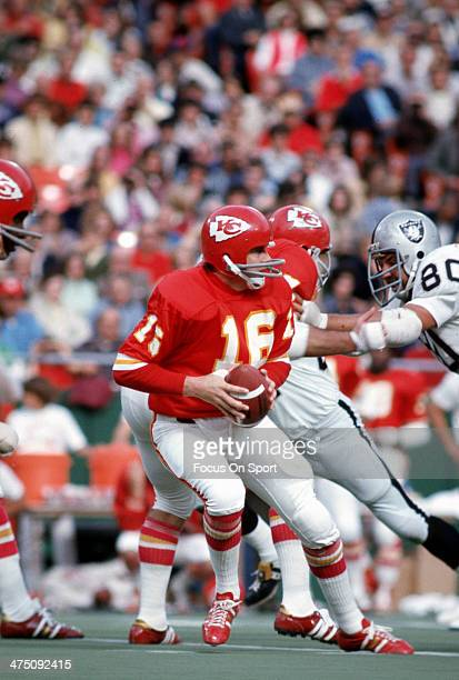 Len Dawson of the Kansas City Chiefs drops back to pass against the Oakland Raiders during an NFL Football game September 30 1973 at Arrowhead...