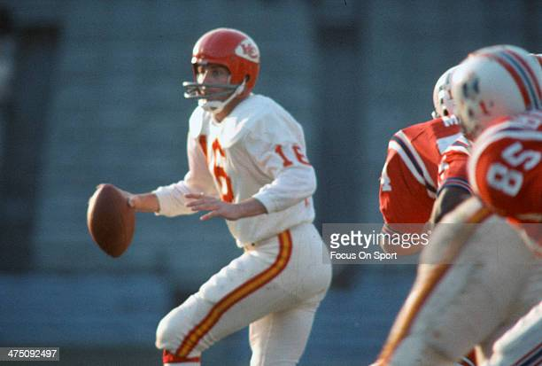 Len Dawson of the Kansas City Chiefs drops back to pass against the Boston Patriots during an AFL Football game September 25 1966 at Fenway Park in...
