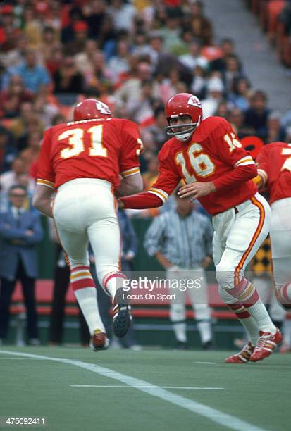 Len Dawson of the Kansas City Chiefs hands the ball off to Jeff Kinney against the Oakland Raiders during an NFL Football game September 30 1973 at...