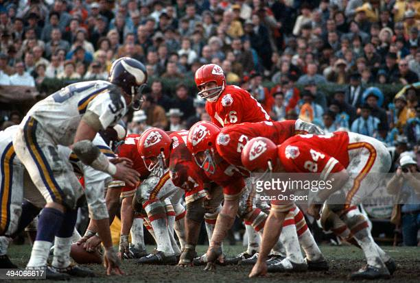 Len Dawson of the Kansas City Chiefs stands under center and calls out the signals against the Minnesota Vikings during Super Bowl IV on January 11...