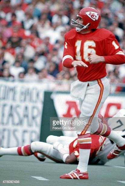 Len Dawson of the Kansas City Chiefs throws a pass against the Oakland Raiders during an NFL Football game September 30 1973 at Arrowhead Stadium in...