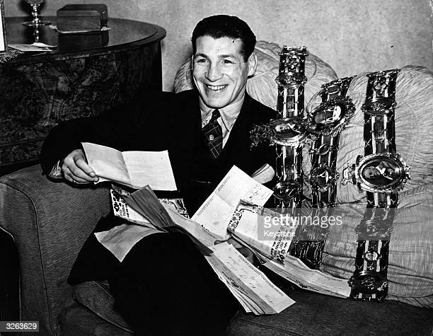 Len Harvey the boxer seen here with his belts and congratulatory telegrams