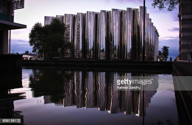 Len Lye Centre with a symmetrical reflection in a water pool