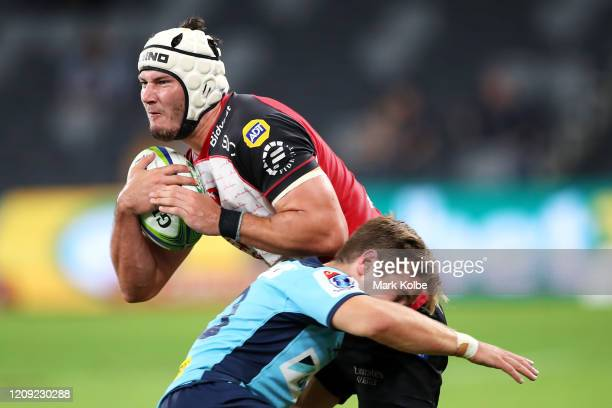 Len Massyn of the Lions is tackled during the round five Super Rugby match between the Waratahs and the Lions at Bankwest Stadium on February 28,...