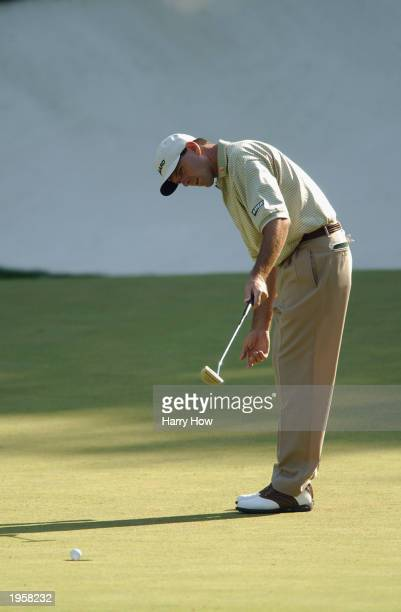 Len Mattiace of the USA watches his eagle putt drop on the 13th hole during the final round of the 2003 Masters Tournament at the Augusta National...