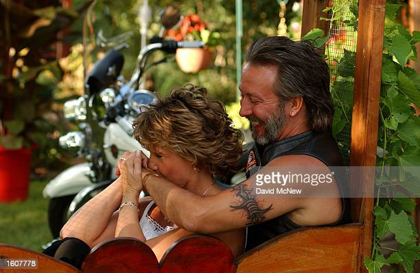 Len McCargar and Denise Karan of Mankato MN sit together near their motorcycle after exchanging marriage vows at the 61st annual Sturgis Motorcycle...