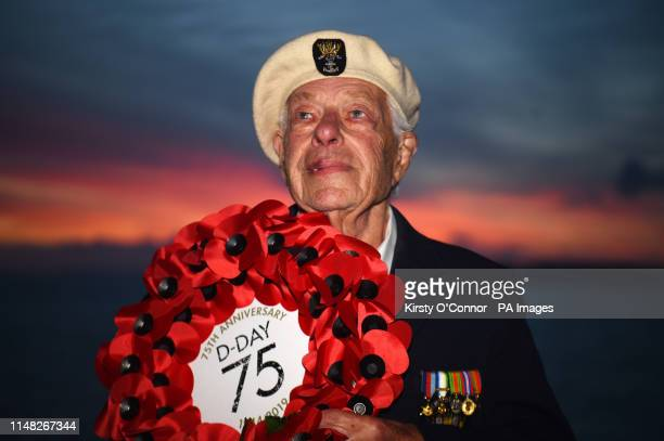 Len Perry from London holds a DDay 75 anniversary wreath on the MV Bouddica at Portsmouth UK on the way the Le Harve in France for Thursday's DDay...