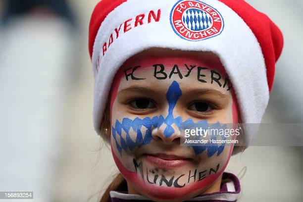 Lena 8 years old supporter of Muenchen battles for the ball with of Hannover during tsmiles prior the Bundesliga match between FC Bayern Muenchen and...