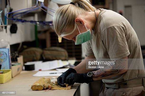 Lena a Swedish forensic technician working with the International Assistance Force in Kabul examines a detonator from an unexploded Improvised...