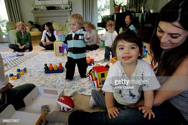 Lena Barnow attends a Sleepy Planet meeting with her 18 month old Sasha in a home in Bel Air Ca on wednesday morning