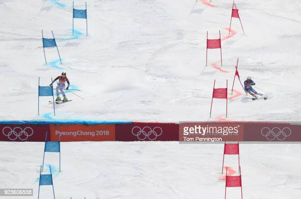 Lena Duerr of Germany and Veronika Velez Zuzulova of Slovakia compete during the Alpine Team Event 1/8 Finals on day 15 of the PyeongChang 2018...