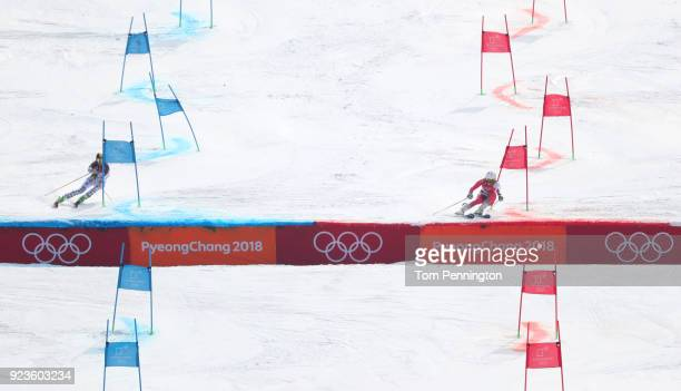 Lena Duerr of Germany and Wendy Holdener of Switzerland compete during the Alpine Team Event Quarterfinals on day 15 of the PyeongChang 2018 Winter...